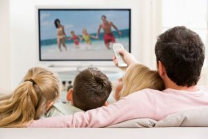 Family Watch Television in hotel